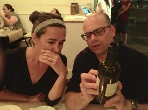 Bernard showing the bottle to Christine